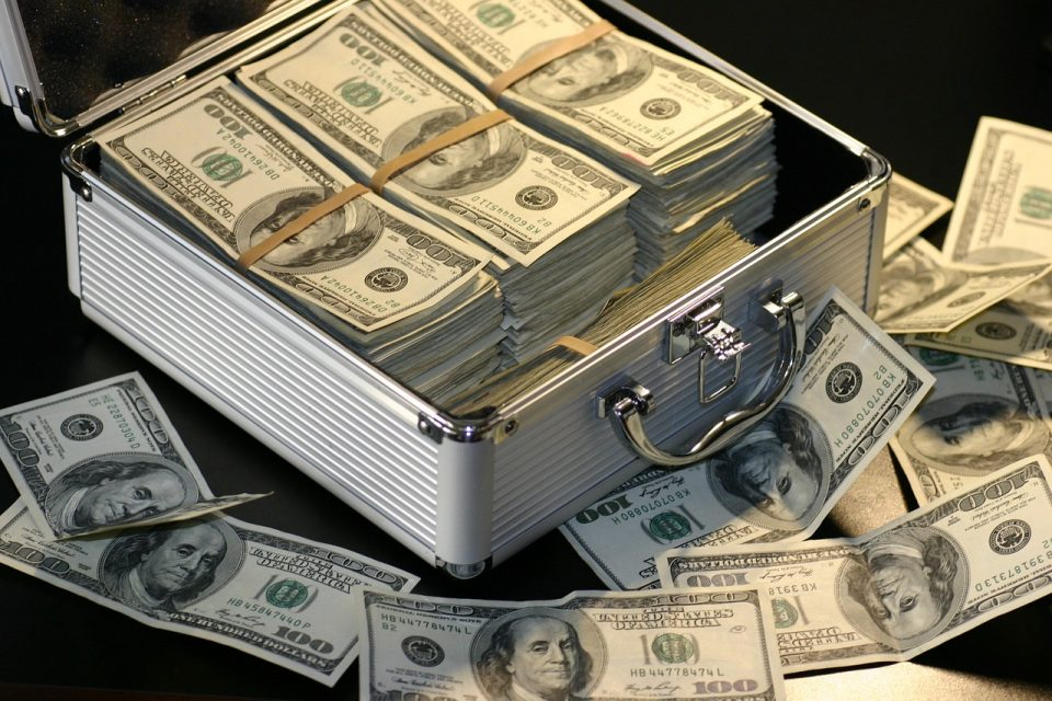 100 dollar bills in suitcase